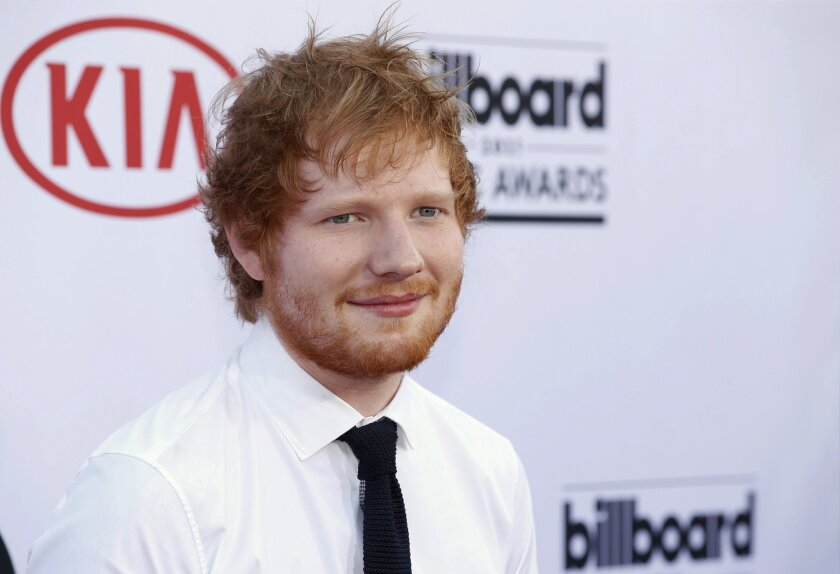 """FILE - In this May 17, 2015, file photo, Ed Sheeran arrives at the Billboard Music Awards at the MGM Grand Garden Arena in Las Vegas. Sheeran was sued by the family of co-writer of Marvin Gaye's """"Let's Get It On"""" on August 9, 2016. The family claims the British singer-songwriter's hit, """"Thinking Ou"""