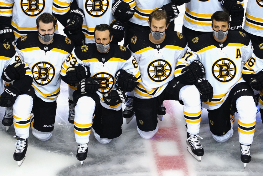 Boston Bruins players pose for a photo before an exhibition game at Rogers Place.