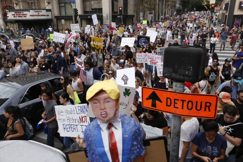 Protesters march along 3rd Street in downtown Los Angeles.