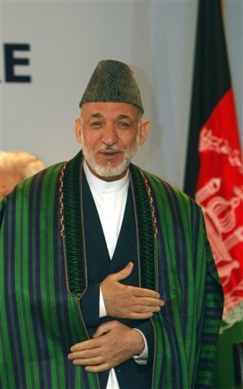 Afghan President Hamid Karzai looks on before delivering a lecture on the last day of his two-day official visit, in New Delhi, India, Wednesday, Oct. 5, 2011. Afghanistan signed a strategic partnership with India on Tuesday, a move likely to enrage neighboring Pakistan at a time when its relations with the Afghans and the West are sharply strained over alleged links of its spy agency to militants blamed for high-profile attacks across the border. (AP Photo/Gurinder Osan)