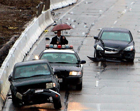 A California Highway Patrol officer was struck and killed early this morning on the eastbound 60 Freeway in Hacienda Heights. The officer was in the No. 4 lane laying down flares when a gray Honda, right, hit the center divider, crossed four lanes and struck the officer. The officer and his partner were on the scene of a previous accident involving a pickup truck, left.