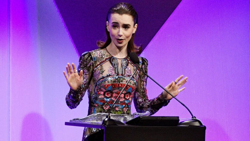 Actress Lily Collins accepts the Lacoste Spotlight Award during the 19th Costume Designers Guild Awards.
