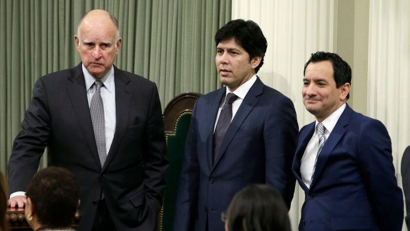 California Gov. Jerry Brown, left, Senate President Pro Tem Kevin de León (D-Los Angeles), center, and Assembly Speaker Anthony Rendon (D-Paramount).,