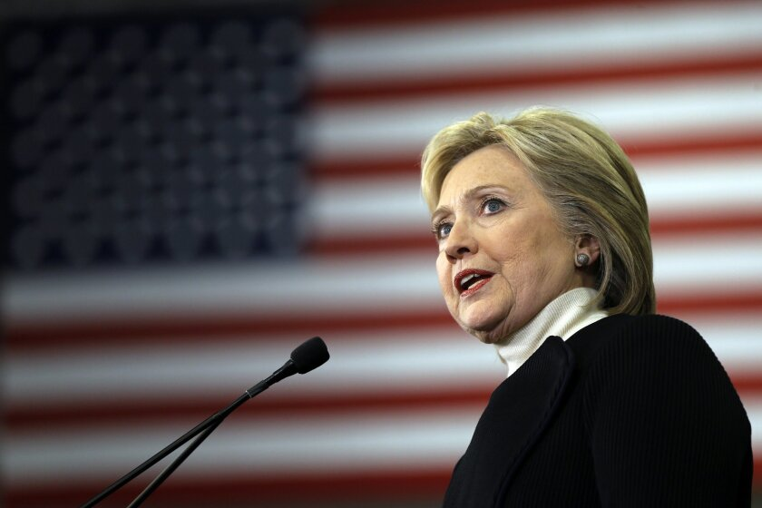 In this Feb. 9, 2016, photo, Democratic presidential candidate Hillary Clinton speaks at her first-in-the-nation presidential primary campaign rally in Hooksett, N.H. Clinton's campaign has spent months fighting the perception that the former secretary of state has a complicated relationship with t