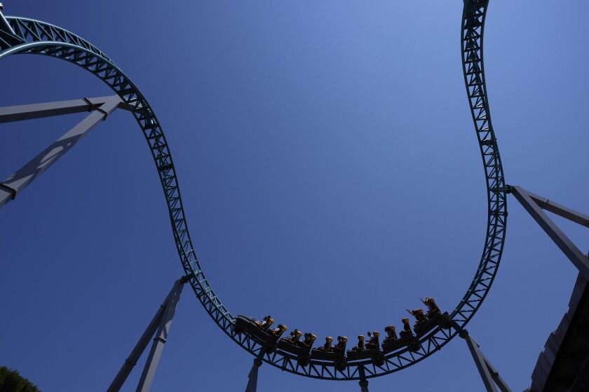 Visitors enjoy a ride on a roller coaster at Cinecitta World amusement park in the outskirts of Rome in the day of its reopening, Thursday, June 17, 2021. Amusement parks have been closed since Oct. 25 2020, when Italy's second national lockdown started. (AP Photo/Alessandra Tarantino)