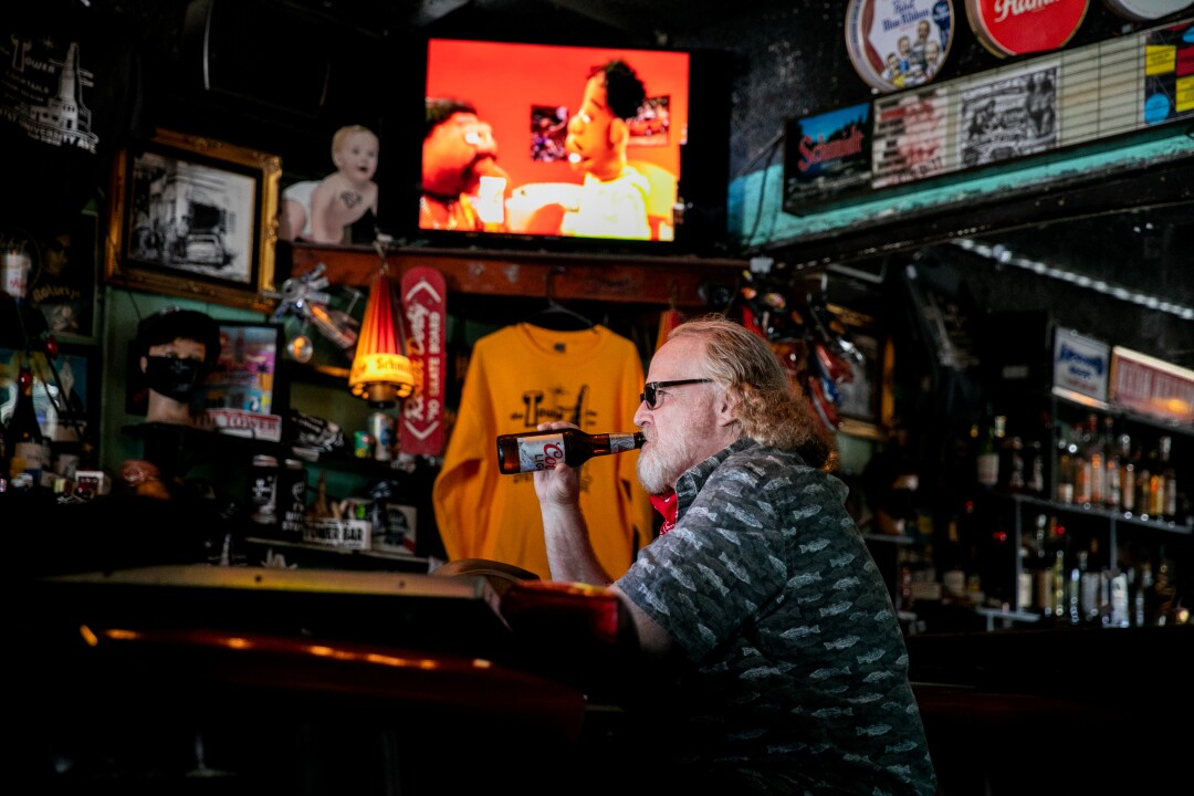 Bruce Grizer sips a cold beer inside The Tower Bar.