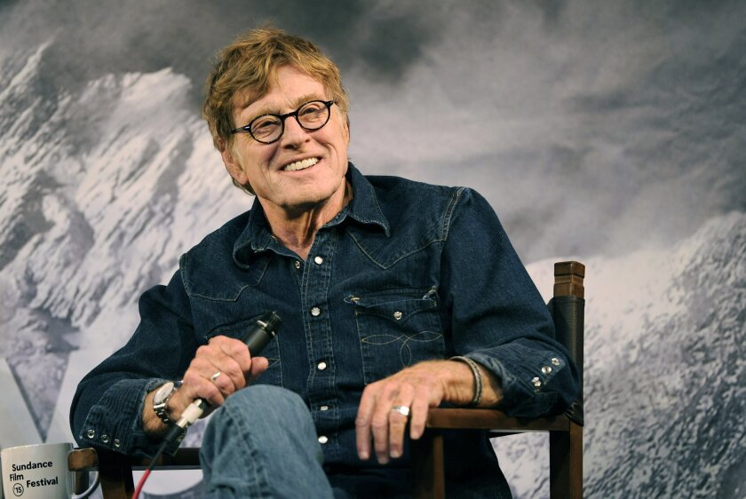 """FILE - In this Jan. 22, 2015 file photo, Robert Redford, founder of the Sundance Institute, interacts with the media during the opening day press conference at the 2015 Sundance Film Festival in Park City, Utah. Redford co-stars with Nick Nolte and Emma Thompson in the film, """"A Walk in the Woods,"""" which releases in U.S. theaters on Sept. 2. (Photo by Chris Pizzello/Invision/AP, File"""