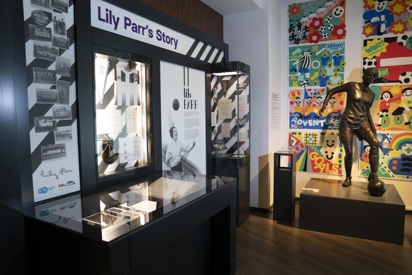 A statue of Lily Parr is displayed at the National Football Museum in Manchester, England, Thursday, July 29, 2021. Lily Parr, whose record-setting career was overlooked when the bosses of English soccer shunned the women's game, is now the focus of a new permanent exhibition at the National Football Museum in Manchester. (AP Photo/Jon Super)