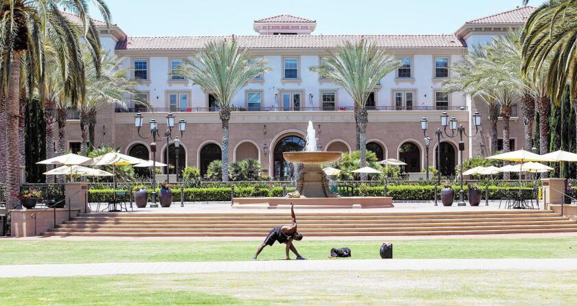 A man works out at the common area of The Park in Irvine.
