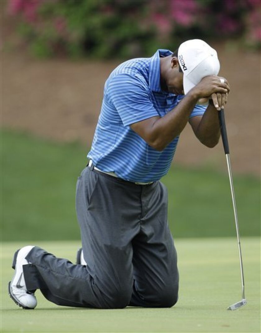 Tiger Woods reacts after missing a putt on the 13th hole during the third round of the Masters golf tournament Saturday, April 9, 2011, in Augusta, Ga. (AP Photo/Charlie Riedel)