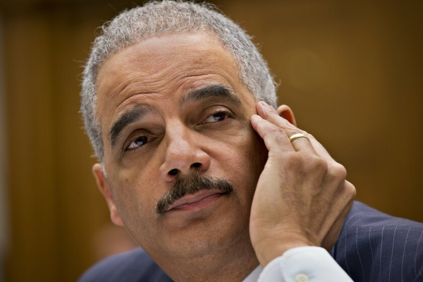 Attorney General Eric Holder, the nation's top law enforcement official, testifies on Capitol Hill in Washington, Wednesday, May 15, 2013, before the House Judiciary Committee oversight hearing on the U.S. Department of Justice. (AP Photo/J. Scott Applewhite)