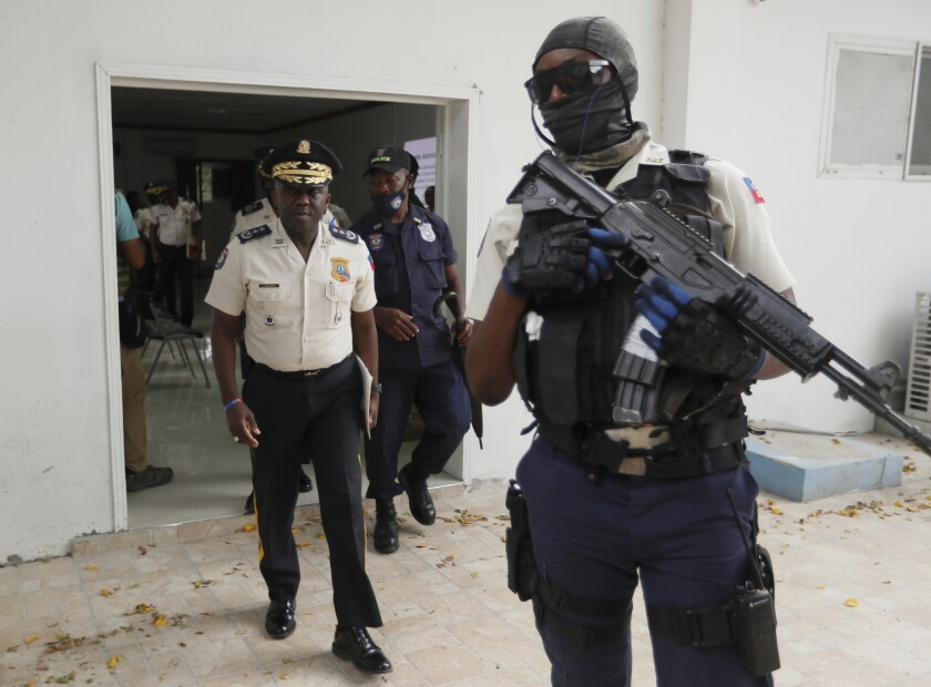 Director general of Haiti's police with armed guard