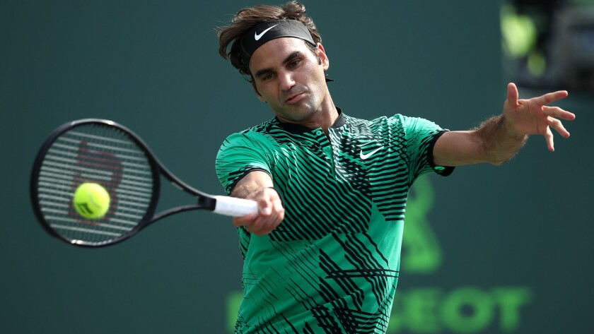 Roger Federer returns a shot against Tomas Berdych during their quarterfinal match at the Miami Open on Thursday.