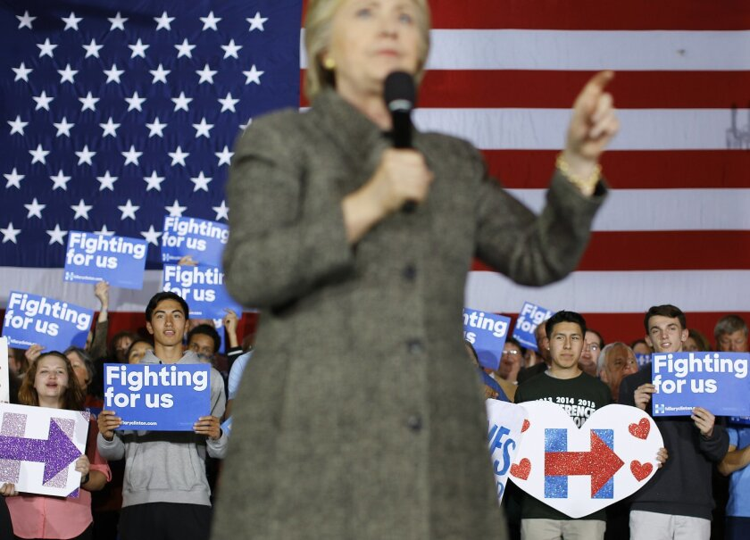 Attendees listen as Democratic presidential candidate Hillary Clinton speaks at a rally at the Riverside Ballroom in Green Bay, Wis., Tuesday, March 29, 2016. (AP Photo/Patrick Semansky)