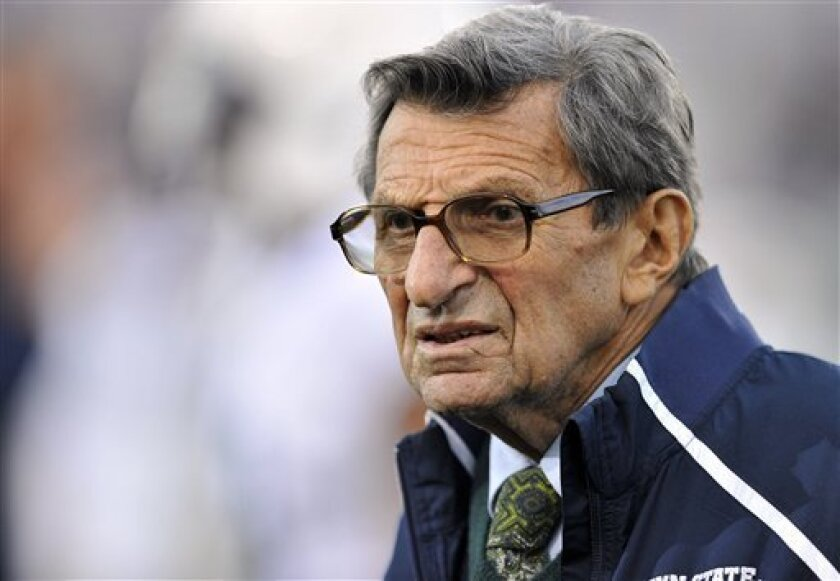 FILE - In this Oct. 22, 2011 file photo, Penn State coach Joe Paterno stands on the field before his team's NCAA college football game against Northwestern, in Evanston, Ill. Paterno and his wife donated $100,000 last month to Penn State, money that was split between a library and an undergraduate fellows program that bear the family name. (AP Photo/Jim Prisching, File)