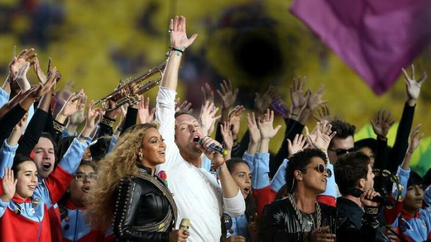 SANTA CLARA, CA - FEBRUARY 07: Beyonce, Chris Martin of Coldplay and Bruno Mars perform during the Pepsi Super Bowl 50 Halftime Show at Levi's Stadium on February 7, 2016 in Santa Clara, California. (Photo by Patrick Smith/Getty Images) ** OUTS - ELSENT, FPG, CM - OUTS * NM, PH, VA if sourced by CT, LA or MoD ** (Getty Images)