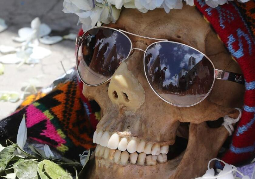 A view of a human skull called 'natita' on the occasion of the 'natitas' festivity, in La Paz, Bolivia, 08 November 2018. The celebrations to honor the dead in Bolivia started past 01 November and ends today with the peculiar festivity dedicated to these human skulls which are believed to possess protective capabilities. EPA-EFE/Martín Alipaz