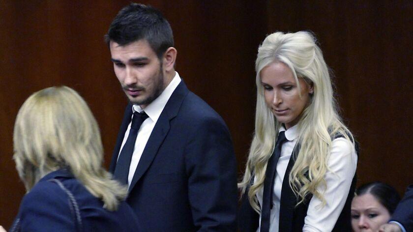 Los Angeles Kings' Slava Voynov enters Superior Court with his wife, Marta Varlamova, Thursday July