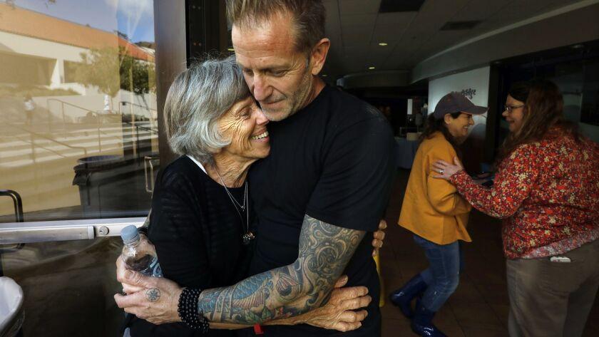 MALIBU, CALIFORNIA--NOV. 22, 2018--Jody Gabbard, right, age 48, hugs his mother Kay Gabbard, age 75,