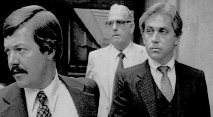 Jeffrey MacDonald, right, appears in federal court in Wilmington, N.C., on Aug. 28, 1979. MacDonald's pregnant wife and two young daughters were killed in their Ft. Bragg home in 1970.