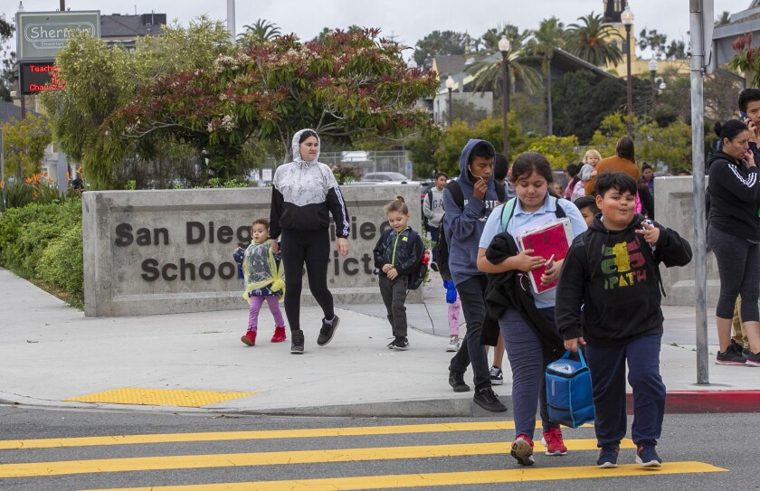 Students are picked up as school lets out at Sherman Elementary school in Sherman Heights, just east of downtown San Diego, on March 13, 2020. Earlier in the day it was announced that school will be canceled starting Monday because of the COVID-19 virus.