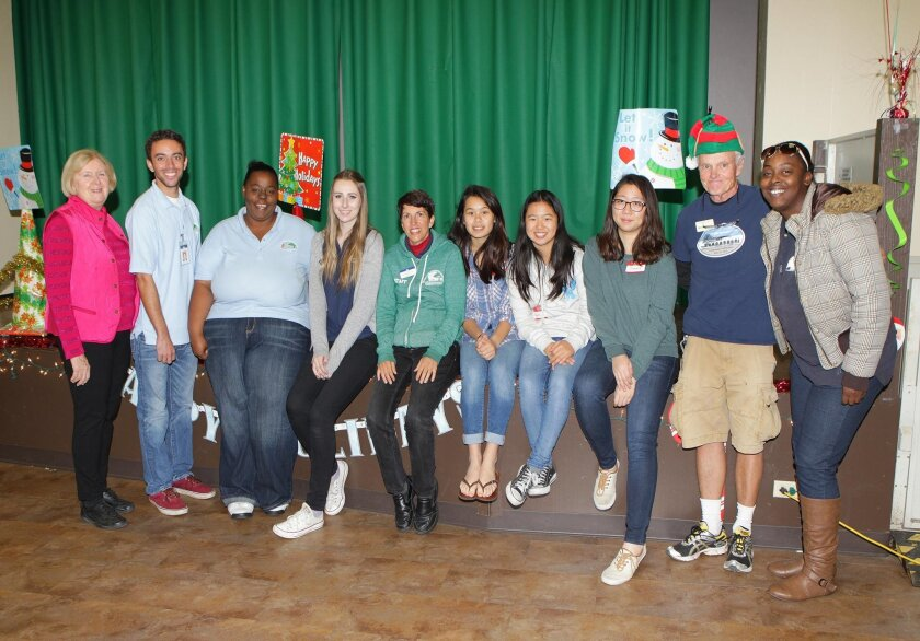 Santa's helpers and volunteers during the La Jolla Recreation Center's annual lunch with Santa Claus, Dec. 19, 2015 include Pat Miller, Wesley Giubilato, LaShay Walker, Alexis Balmer, Lisa Daleo, Vyvian Pham, Emilie Tu, Chae Yoon Baek, Bill Robbins and Dajasia Morales.
