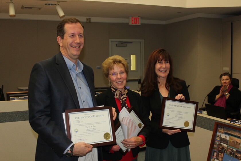 Solana Beach council members David Zito, Judy Hegenauer and Jewel Edson (l-r), display their official certificates of election after taking their oath of office on Wednesday, Dec. 14 at Solana Beach City Hall.