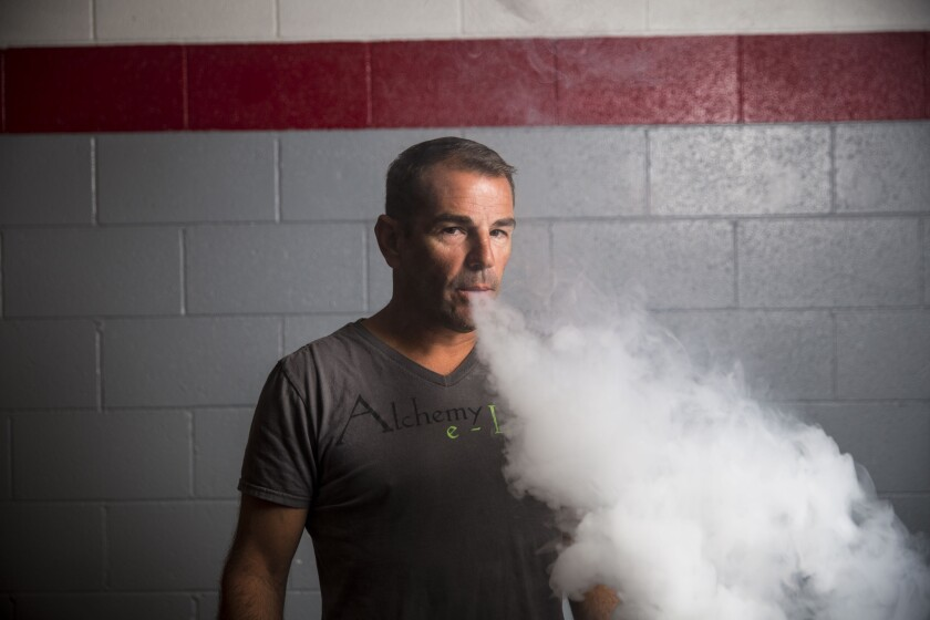 Alarmed by a surge in nicotine poisonings and the potential for abuse, the FDA is considering rules for the vaping industry, which some say could doom small companies such as Robert Steed's two vaping stores.
