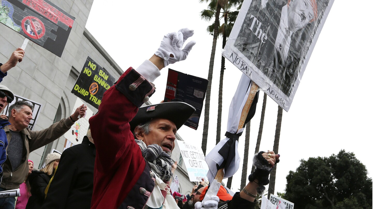 Lawrence Herrera of Los Angeles appears in a colonial costume for the protests outside Los Angeles City Hall.