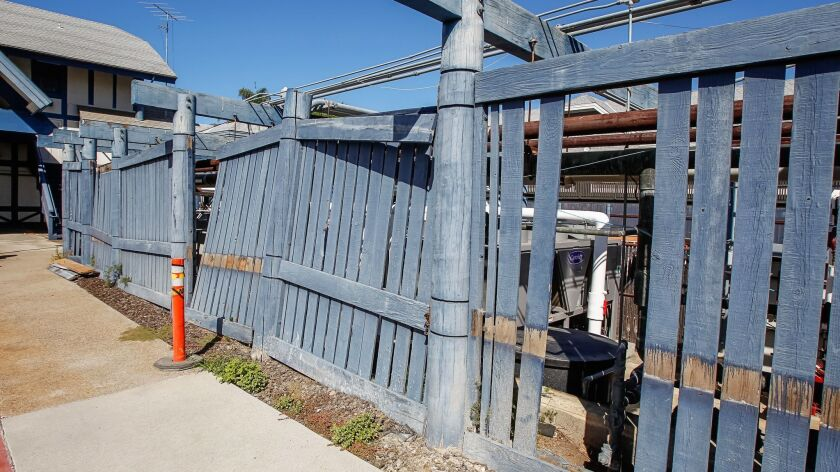 SAN DIEGO, CA October 12th, 2018 | This is a decrepit fence structure housing gas and water lines ne