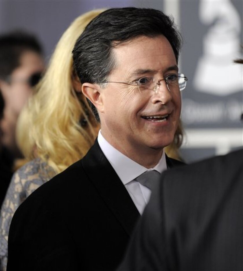 Stephen Colbert arrives at the Grammy Awards on Sunday, Jan. 31, 2010, in Los Angeles. (AP Photo/Chris Pizzello)