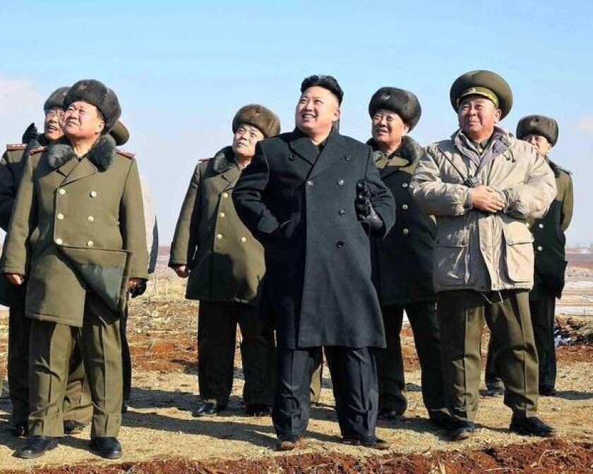 North Korean leader Kim Jong Un, center, appears to enjoy watching a flight exercise in an undated photo released by North Korea's official Korean Central News Agency.