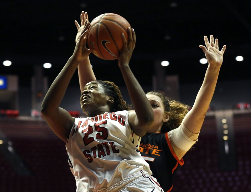 Erimma Amarikwa goes up for a score during SDSU's  women's basketball game against Oklahoma State Sunday afternoon at Viejas Arena.