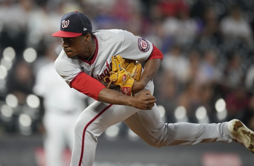 Washington Nationals starting pitcher Josiah Gray works against the Colorado Rockies in the first inning of a baseball game Monday, Sept. 27, 2021, in Denver. (AP Photo/David Zalubowski)