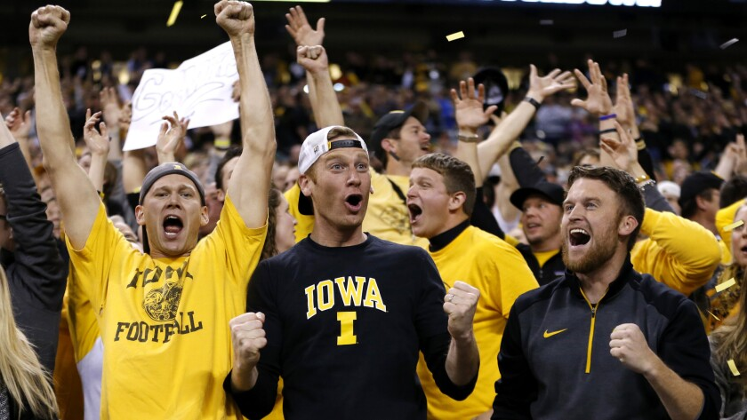 Iowa fans cheer after quarterback C.J. Beathard threw an 85-yard touchdown to Tevaun Smith during the Big Ten Conference championship game on Dec. 5.