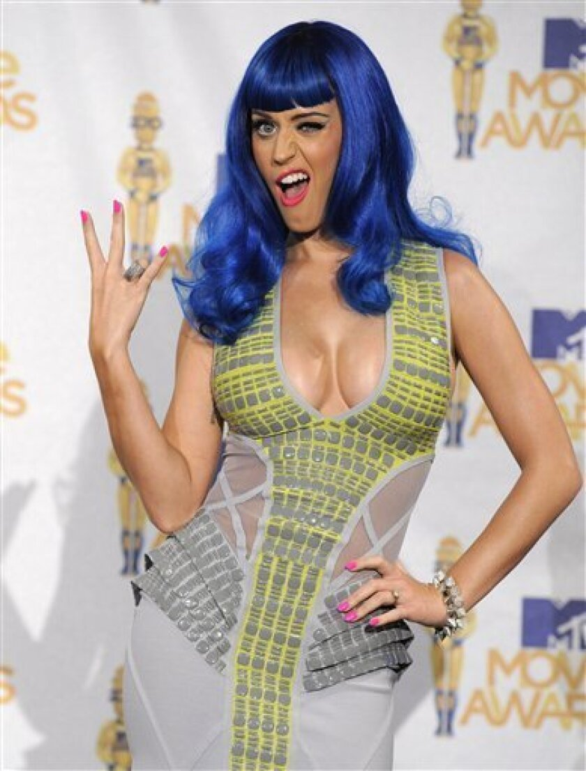 Katy Perry is seen backstage at the MTV Movie Awards in Universal City, Calif., on Sunday, June 6, 2010. (AP Photo/Chris Pizzello)