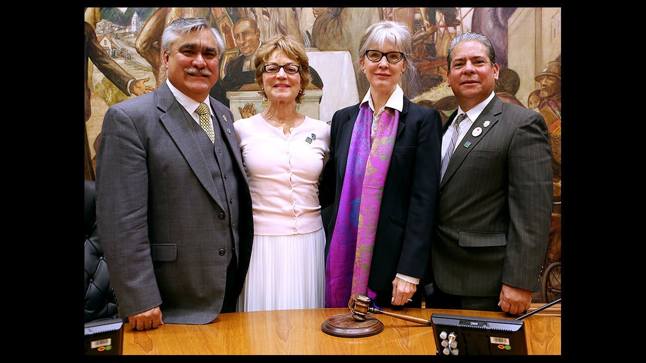 Newly selected mayor Emily Gabel-Luddy, second from right, stands with newly selected vice mayor Sharon Springer, second from left, along with council members Jess Talamantes, left, and Bob Frutos, right, at the end of city council meeting on Tuesday, May 1, 2018. Most recent mayor Will Rogers died recently from complications of liver cancer, at age 60. His widow was honored by the city council.