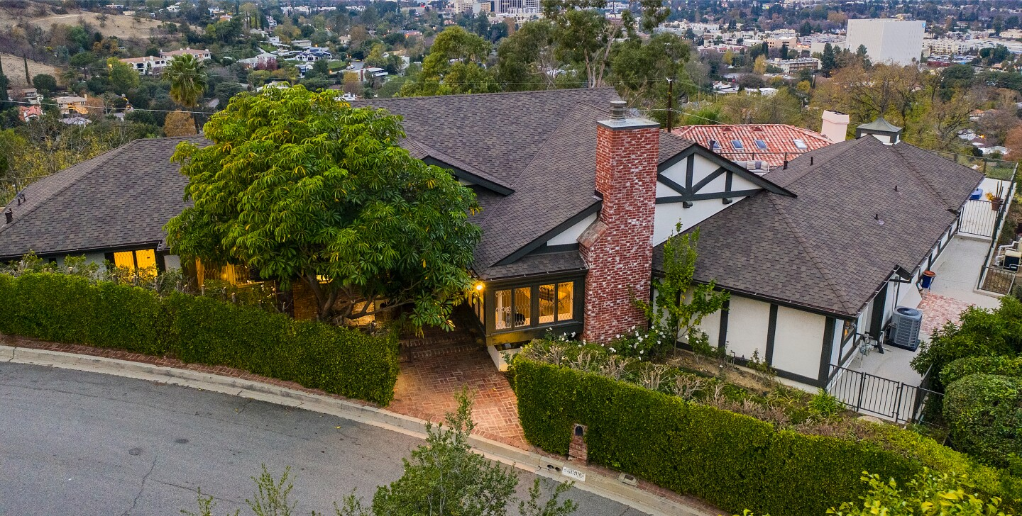 Built in the '70s, the half-timbered Tudor includes a spacious great room, meditation room and scenic patio with a pool and spa.