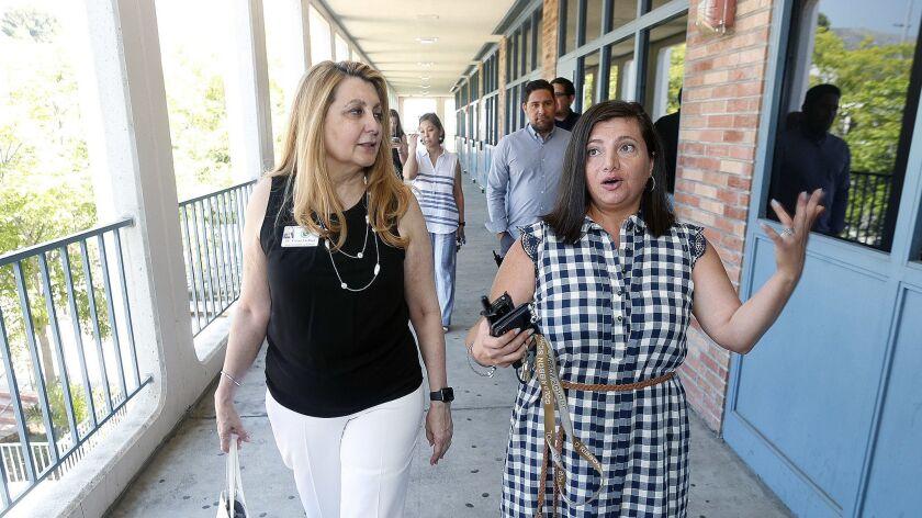 New Glendale Unified School District Superintendent Vivian Ekchian walks with Hoover High School Ass