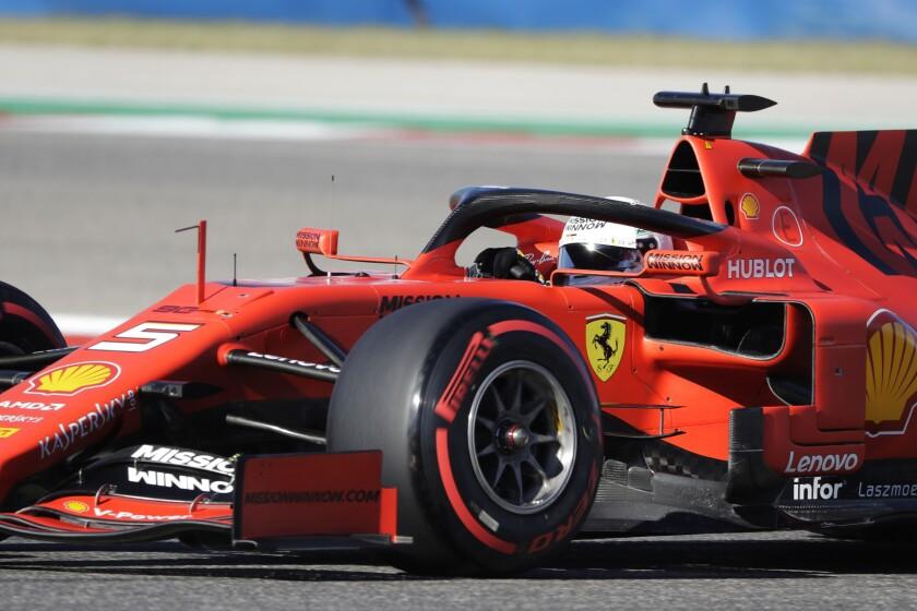 Ferrari driver Sebastian Vettel, of Germany, races in Q1 during qualifying for the Formula One U.S. Grand Prix auto race at the Circuit of the Americas, Saturday, Nov. 2, 2019, in Austin, Texas. (AP Photo/Darron Cummings)