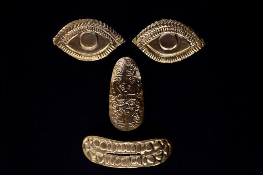 """View of ancient golden facial features on show at the expo """"Sipan: Mystery and Splendor in North Peru"""" in Panama City on March 1, 2019, a display of the treasure from the Moche culture, a pre-Columbian civilization that flourished in northern Peru between the 2nd and 7th centuries. EFE-EPA/Carlos Lemos"""
