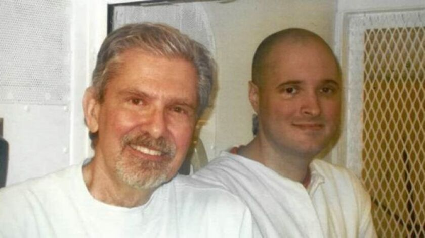 "Kent Whitaker, left, visits his son Thomas ""Bart"" Whitaker in prison in Polunsky, Texas, in October 2016. Thomas Whitaker is scheduled for execution on Feb. 22."