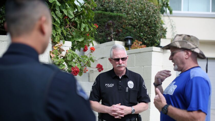 LOS ANGELES, CA-JUNE 6, 2019: Monterey Park Police Officer Lee Norris, center, speaks to Eric Blomg