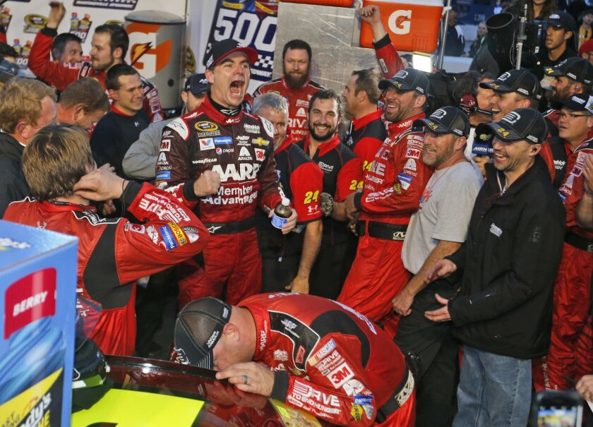 Jeff Gordon celebrates winning the Sprint Cup auto race at Martinsville Speedway in Martinsville, Va., Sunday, Nov. 1, 2015. (AP Photo/Steve Helber)