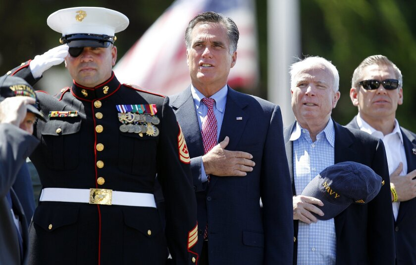 Marine veteran Nick Popaditch, left, former Gov. Mitt Romney, Sen. John McCain, and Veteran of the Year David Dickey all spoke to a crowd of nearly 5,000 at a  Memorial Day tribute at the Veterans Museum and Memorial Center on Monday.