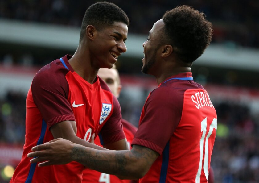 England's Marcus Rashford, left, celebrates his goal with Raheem Sterling, during the international friendly soccer match between England and Australia at the Stadium of Light, Sunderland, England, Friday, May 27, 2016. (AP Photo/Scott Heppell)