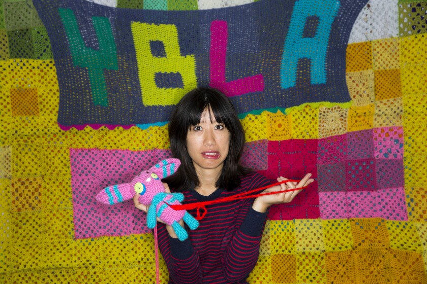 """Carol Zou takes over Yarn Bombing Los Angeles (YBLA), a self-described group of """"guerrilla knitters."""""""