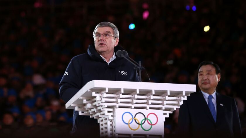 IOC President Thomas Bach speaks at Closing Ceremony as Lee Hee-beom, President & CEO of PyeongChang Organizing Committee, looks on.