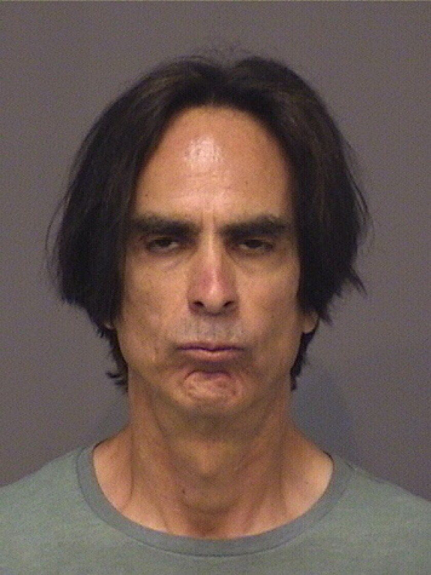 Charles Jacques was arrested at his home in Huntington Beach on Thursday morning.