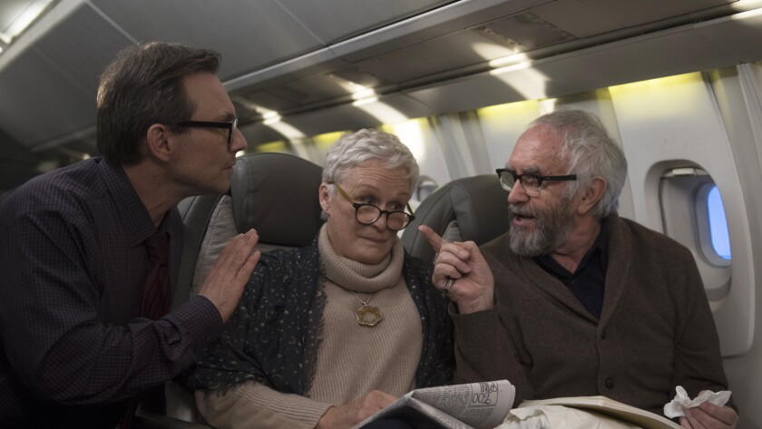 "Christian Slater, left, Glenn Close and Jonathan Pryce in the movie ""The Wife."""